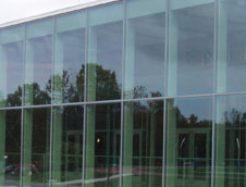 Custom commercial glass and glazing for windows, doors, glass curtain walls, and folding glass walls.